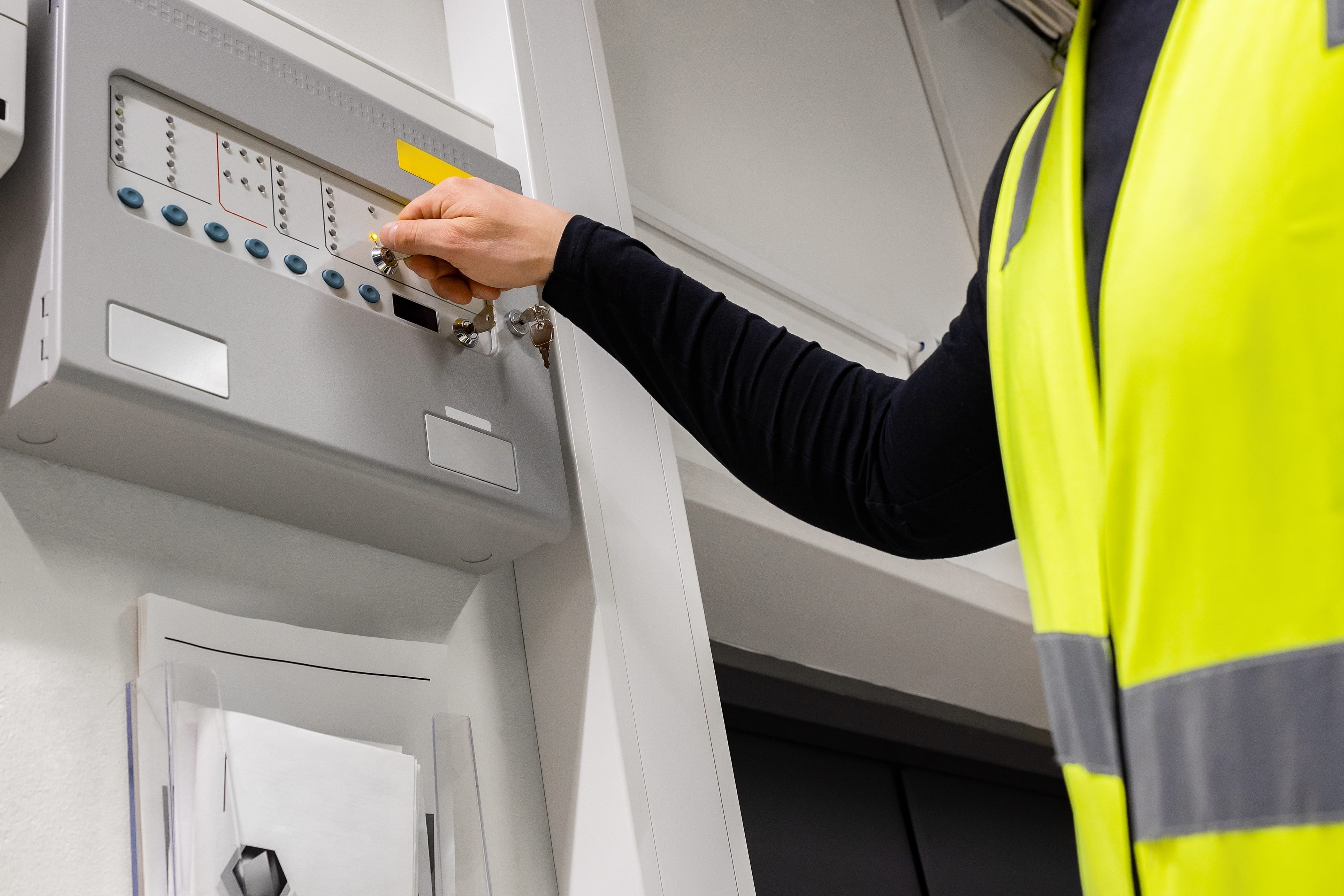 electrician opening fire panel in server room